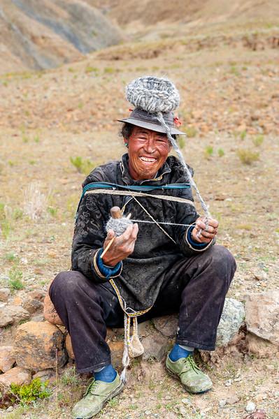Tibetan shepherd wearing the wool hat he knits while tending his flock, near Ngor Monastery, Shigatse, Tibet