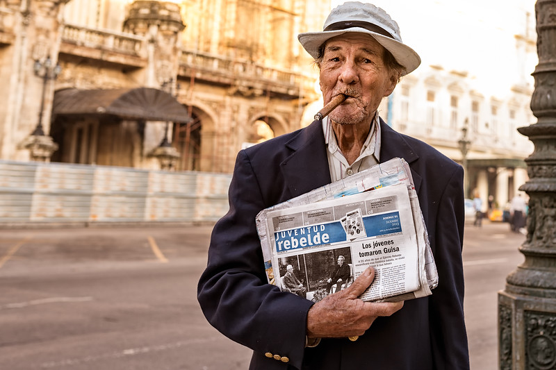 "Man with ""Rebel Youth"" paper in Havana, Cuba"
