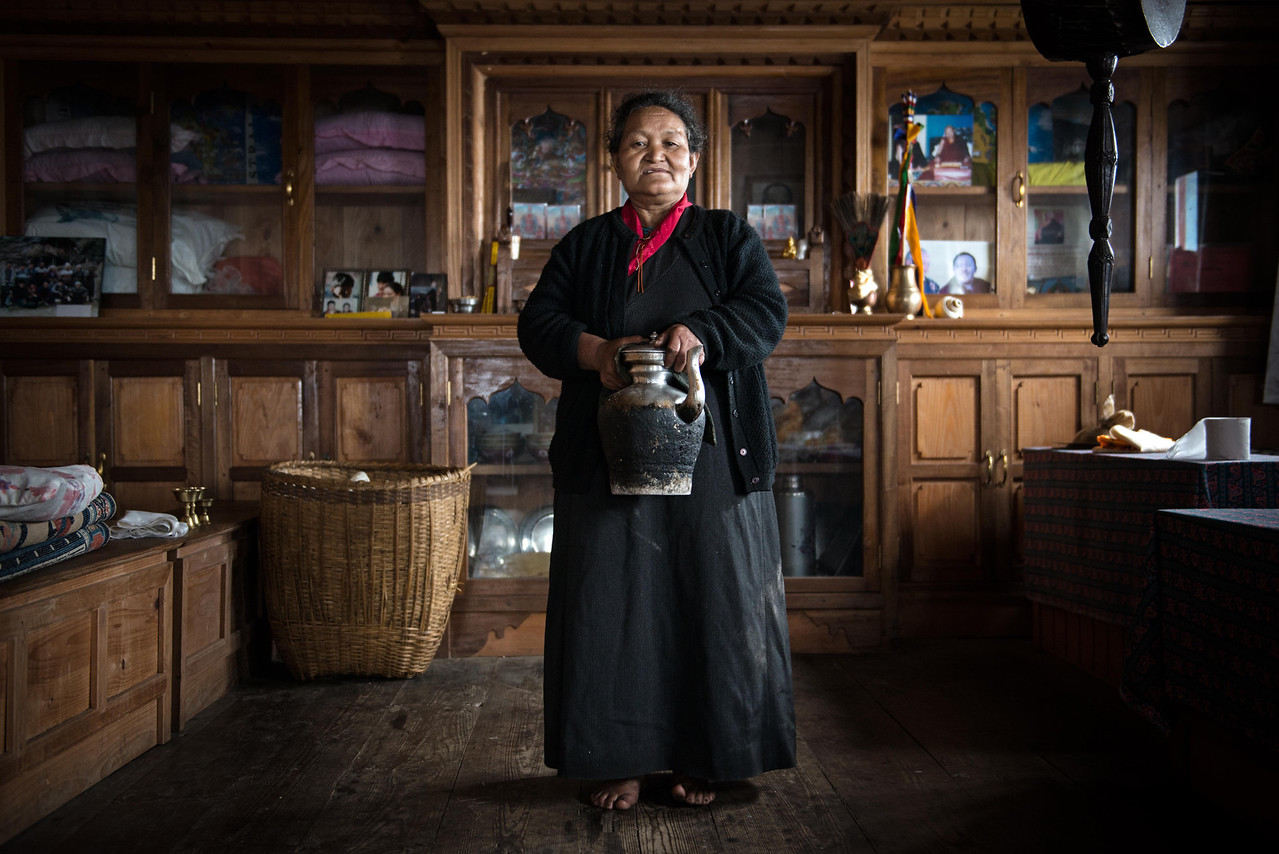 A sherpa woman poses for a photo in her in-house prayer room.
