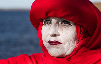 Martina Dunne dressed as a 'Red Rebel' representing the Extinction Rebellion group who were protesting on the picturesque shore of Lough Melvin, Co Fermanagh against Fracking in the area.  Picture: Ronan McGrade.