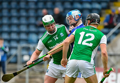 Eoin Cleary shrugs off the Cavan challenge as Nathan Timoney looks on.  Photo: Ronan McGrade