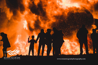 Brave spectators keep warm near the Cornagrade Halloween bonfire.  Picture: Ronan McGrade