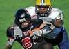 Image © 2010 Ralph Mawyer, Jr.|| Texas A&M Commerce defender tackles University of Incarnate Word running back, Trent Rios, 13 Nov 2010, San Antonio, Texas