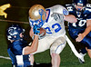 Image © 2008 Ralph Mawyer, Jr.|| Boerne-Champion defender caught in illegal facemask tackle of Alamo Heights running back, 3 Oct 2010, Boerne, Texas.