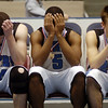 News photo by Ben French<br /> Painful sight<br /> Hilliard Darby players (from left) Austin Brown, Jeremy Ball and Andrew Crawford can't bear to watch the medal ceremony after the Panthers' 45-43 loss to Upper Arlington in the Central District Championship game on Saturday. Story, Page XXXXXXXXXXXXXXXXXXXXXXXXXX.<br /> <br /> <br /> Hilliard Darby players (from left) Austin Brown, Jeremy Ball and Andrew Crawford can't bear to watch the rest of the medal ceremony after the Panthers' 45-43 loss to Upper Arlington in the Central District Championship game at the Coliseum Saturday. Story, Page XX