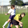 Fremont's #4 heads the ball over the referee.<br /> Photo Ben French