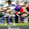 Elon Simms leaps a hurdle in the 110M hurdles.<br /> Photo Ben French