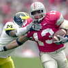 Clarett avoids #21 (?) of Michigan in the first quarter.<br /> Photo Ben French