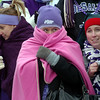 DeSales seniors Julia Judson, from left, Breanna Watzka, and Theresa Hunt bundle up in the stands of Massillon Paul Brown Tiger Stadium on Friday as they watch the game.