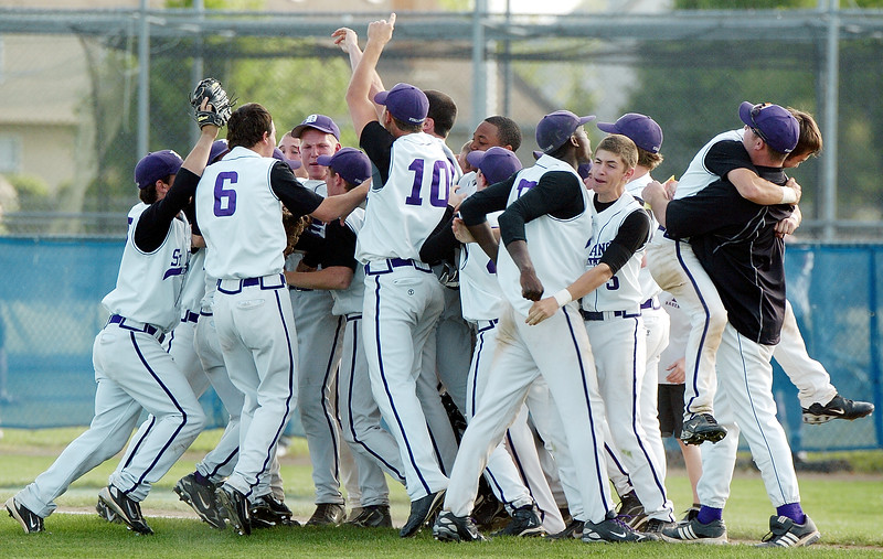 The St. Francis DeSales team celebrates the win over Bishop Watterson to claim the division II district title on Thursday at Grove City.