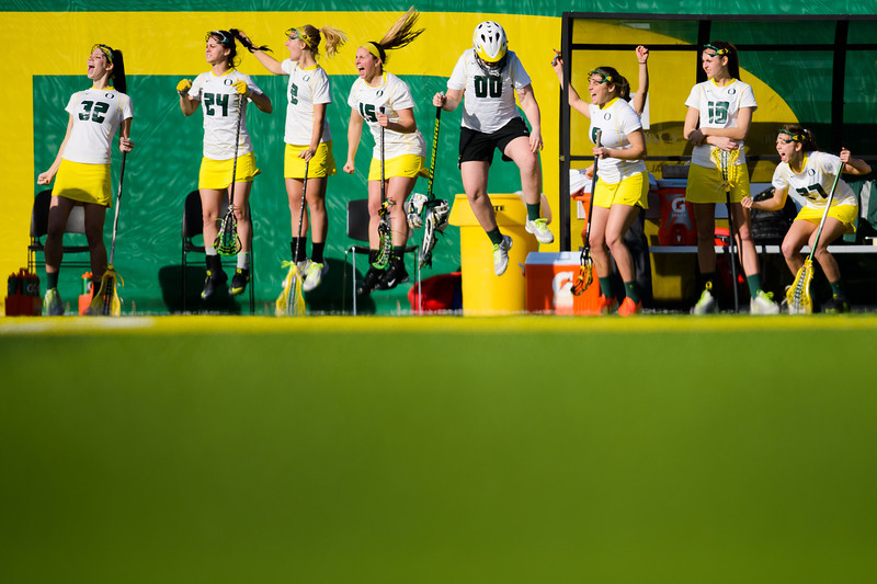 The Oregon bench reacts jubilantly after Ducks attacker Sami Kiser (4) scores a goal with seconds remaining in the first half, making it a 5-2 game for Oregon. The Oregon Ducks play the Connecticut Huskies at Papé Field in Eugene, Ore. on March 14, 2014.
