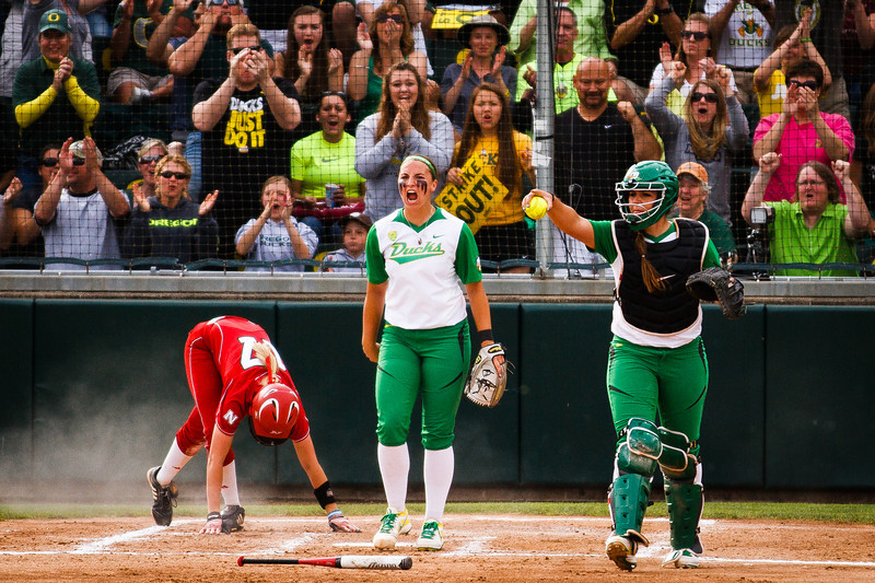 Oregon pitcher Jessica Moore, center, screams in celebration along with her teammate Janelle Lindvall after Lindvall outed Huskers infielder Mattie Fowler (17) at home plate during the top of the third inning in Eugene, Ore. on May 25, 2013.