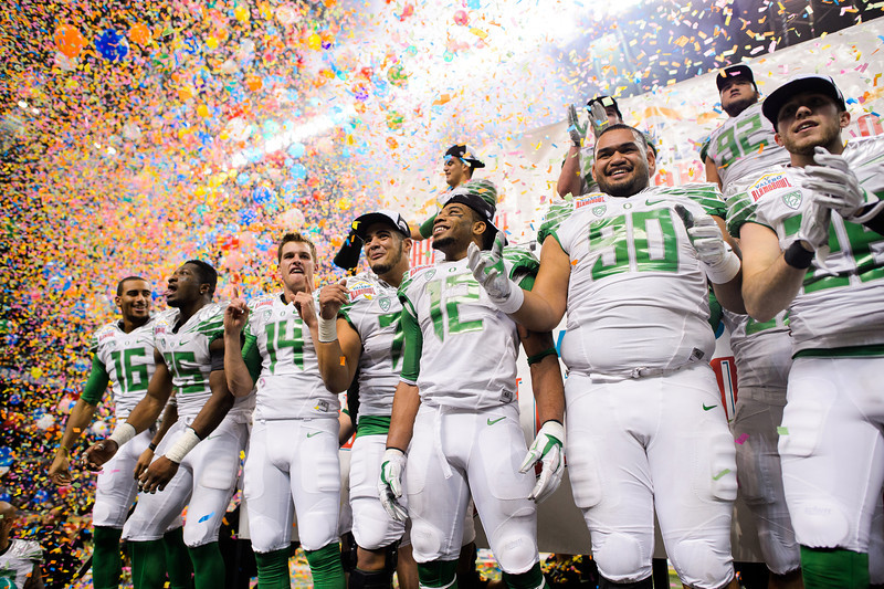 The Ducks celebrate their victory in the 21st Alamo Bowl on the winner's platform. The No. 10 Oregon Ducks play the Texas Longhorns in the Alamo Bowl at the Alamodome in San Antonio, Texas on Dec. 30, 2013.
