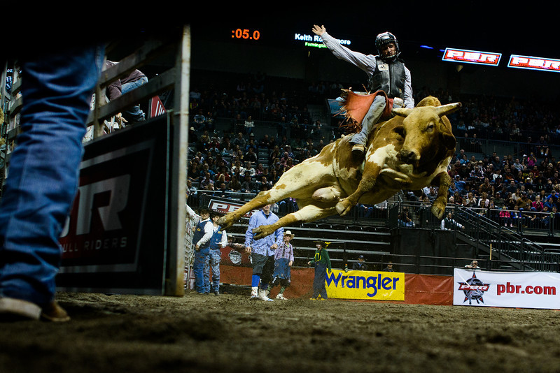 Farmington, N.M. native Keith Roquemore and his bull make an acrobatic exit from the cage during the first second of the rodeo rider's thrashing journey at the PBR Rodeo in Eugene, Ore. on Feb. 2, 2013.