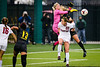 Cardinal goalkeeper Jane Campbell, left, collides with Oregon forward Kristen Parr, right, as Cambell attempts to punch the ball out of the goal box during the final minutes of the first half. The Oregon Ducks play the No. 8 Stanford Cardinal at Papé Field in Eugene, Ore. on Oct. 25, 2013.