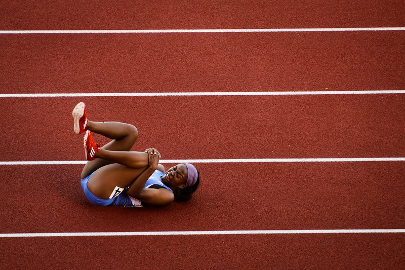 UCLA's Brea Buchanan writhes in pain on the track after crashing to the ground on her knee and elbow on the final hurdle in the women's 100 meter hurdles during the NCAA Track and Field Championships at Hayward Field in Eugene, Ore. on June 6, 2013.
