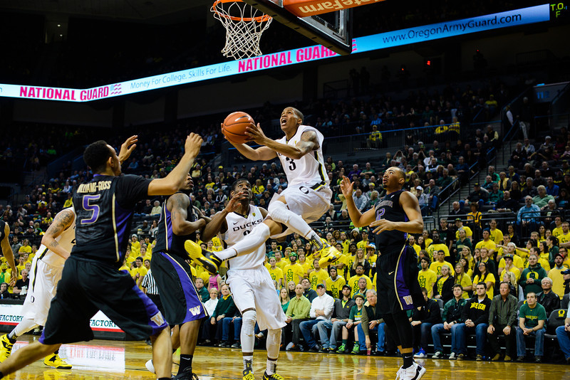 Oregon redshirt junior guard Joseph Young (3) puts up an acrobatic two-pointer in the paint during the first half. The Oregon Ducks play the Washington Huskies at Matthew Knight Arena in Eugene, Ore., on Feb. 19, 2014.