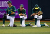 Oregon outfielder Connor Hofmann, center, clutches his face in despair as hope for the Ducks fades entering the eight inning with a 8-4 hole to the Rice Owls. The Ducks were handled by the Rice Owls 11-4 at PK Park on June 3,  2013, ending Oregon's hopes for advancement to the NCAA Super Regionals.