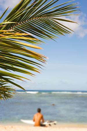 Surfer on beach, Honolulu, Oahu, Hawaii USA