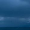 Lone sailboat on horizon, Hawaii USA
