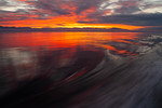 Motion blur behind boat at sunset, Strait of Georgia, BC Canada