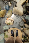 2 feet in rubber boots on rocky beach, Port Angeles, WA USA