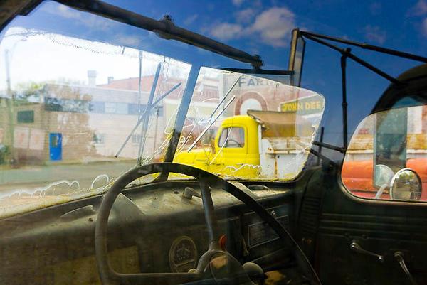 Sky reflection in old truck side window, Sprague, WA USA