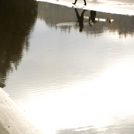 Reflection of surfers in tide pool, Port Angeles, WA USA