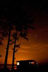 Illuminated cabin under stars, Joyce, WA USA