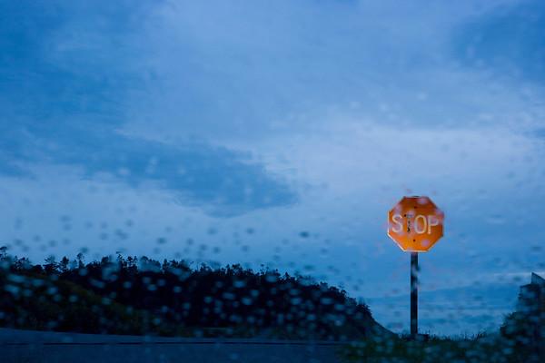 Stop sign seen through rainy windshield, WA USA