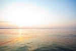 Sun setting on Shilshole Bay on Puget Sound, Seattle, WA USA