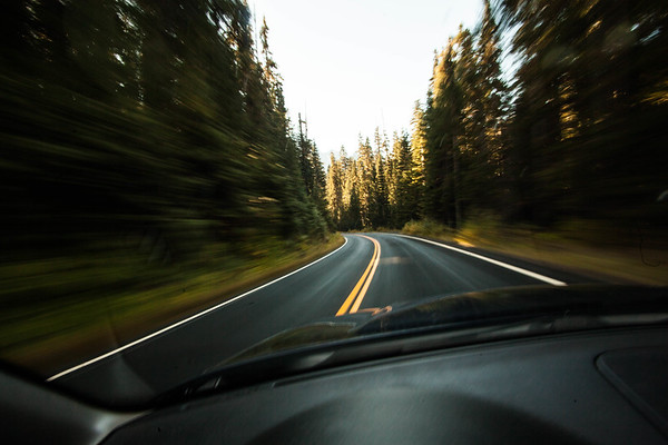 Driver's windshield view on two lane highway, Mt Rainier National Park, WA USA