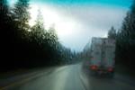 Semi-truck on rainy interstate, WA USA