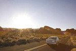 Car on highway in Valley of Fire Park, Nevada USA