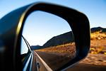 Side mirror vanishing perspective in Nevada desert, USA