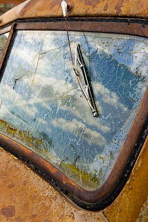 Sky reflection in broken old truck windshield, Sprague, WA USA