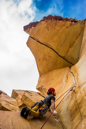 Climber beginning the second pitch of Desert Gold in Red Rocks, Nevada.