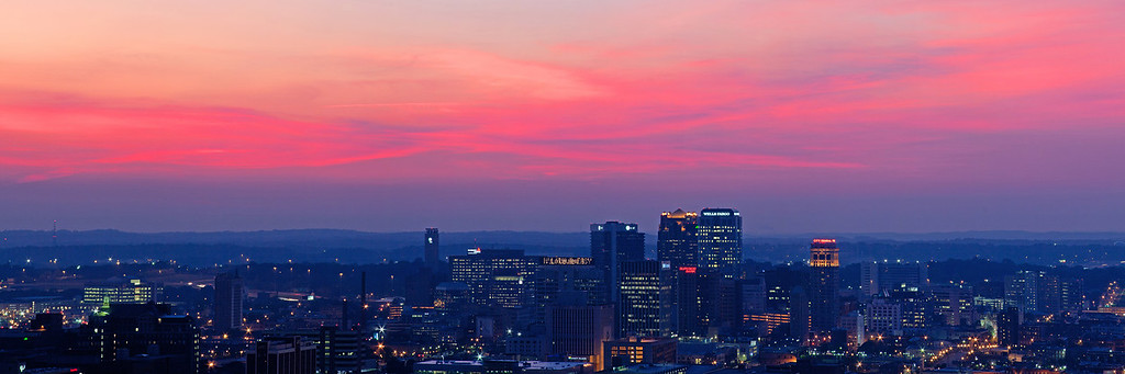 IMAGE: http://www.litton-photography.com/Places/The-Southeast/i-kTNG3RP/0/XL/Birmingham-Pano-pinkishred-sky-XL.jpg