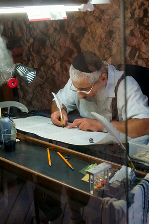 Scribe on top of Masada writing a torah
