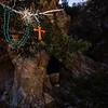 Cross necklace at entrance to migrant cave shelter, US-Mexico border, Santa Cruz County, Arizona