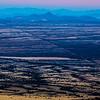 View of US-Mexico border wall from Coronado National Memorial, Huachuca Mountains, Cochise County, Arizona and Sonora, Mexico