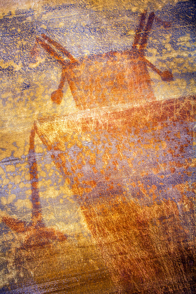 Horned figure with knife and incised details, Fremont pictograph, Utah