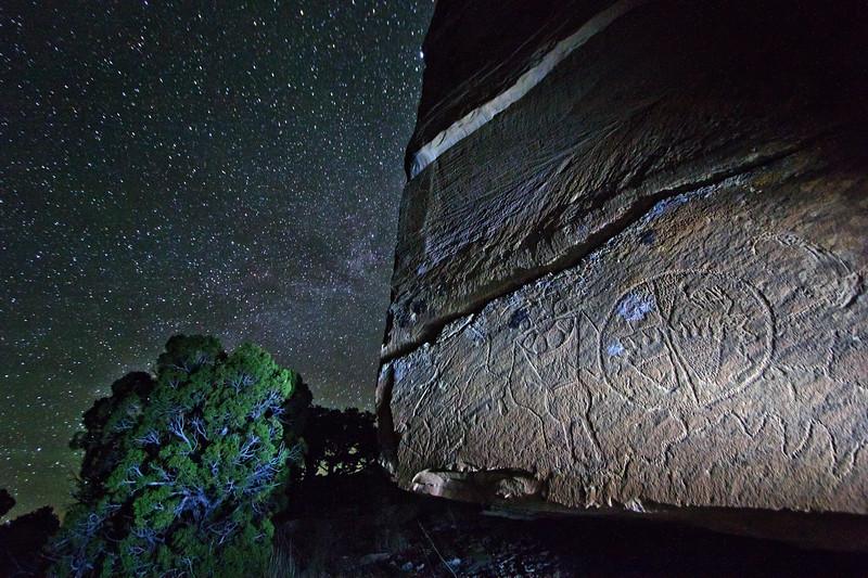 Fremont figure with bear print shield under the night sky, Utah