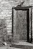 The front door of an old fishing shanty, with stacked crabpots, sits in dissaray on Deal Island Maryland