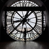 A beautiful silhouette framed by an enormous clock at the Musee d'Orsay, with Sacre Coeur in the background.