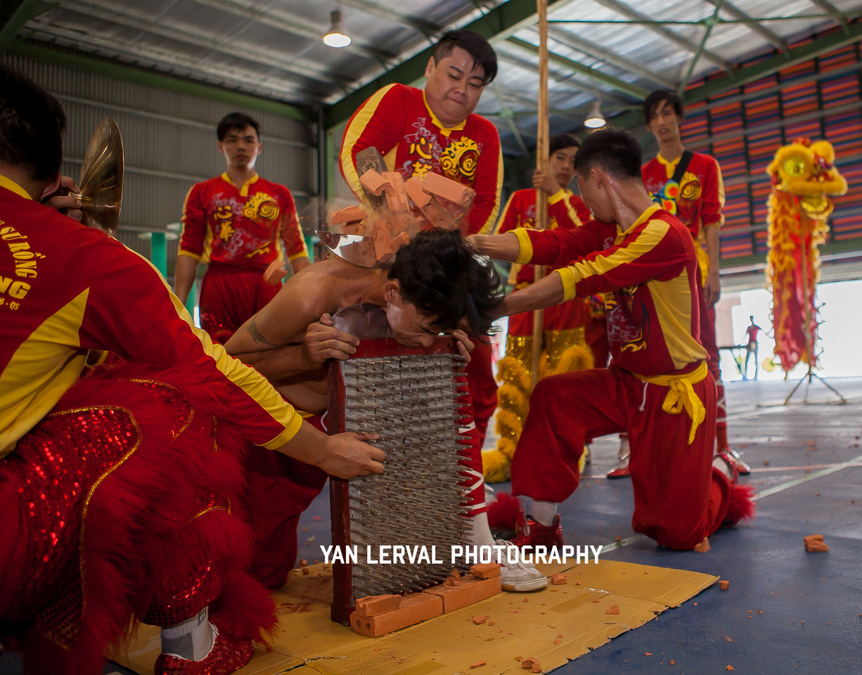 Bricks breaking during a Têt performance. Ho Chi Minh City, Vietnam