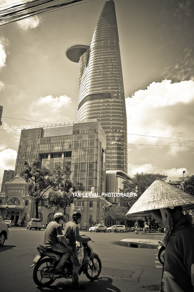 Contrast between a traditional Vietnamese hat and this huge, modern Bitexco Tower. In Dist. 1, HCMC