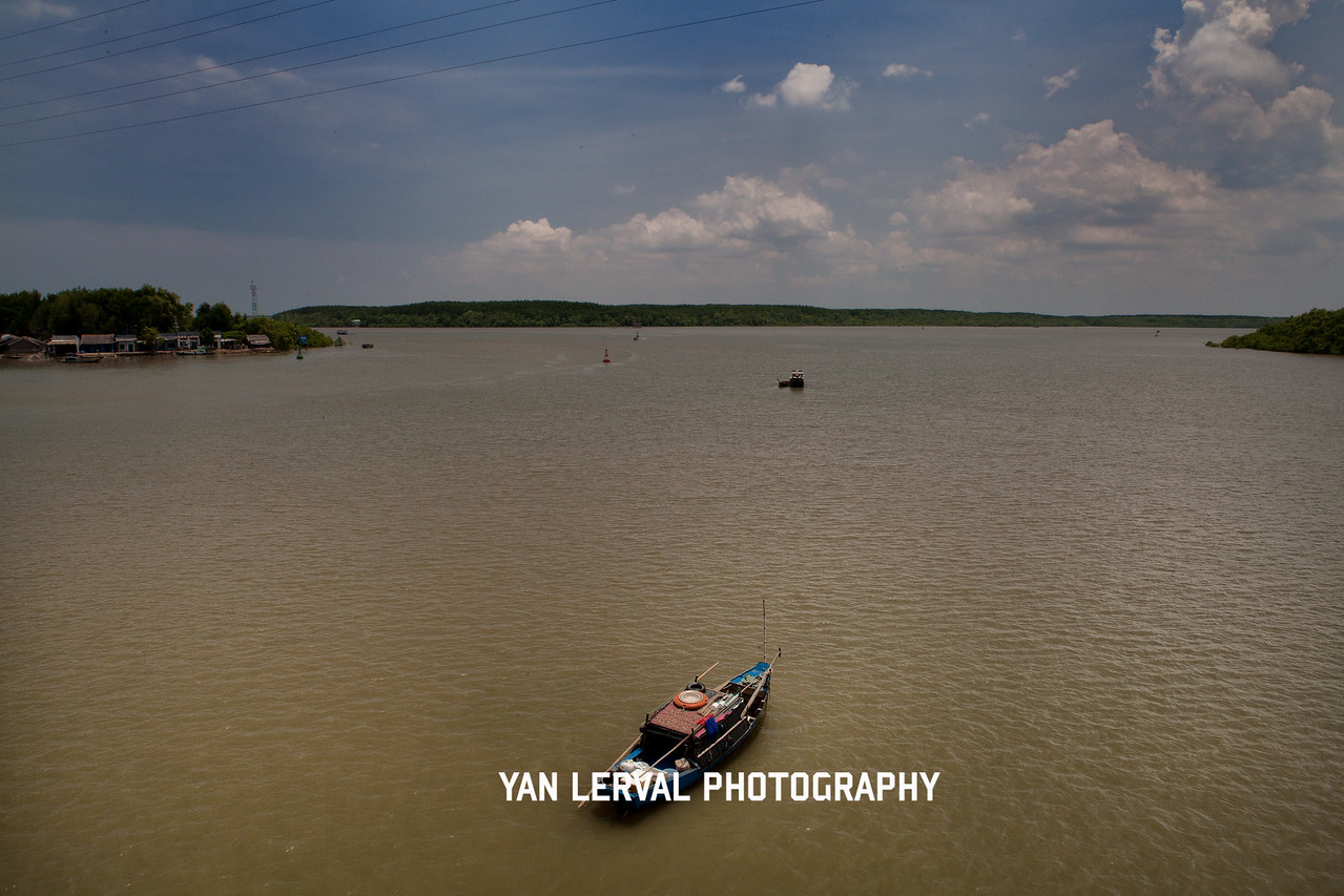 Saigon River getting larger as we are approching the sea in Vung Tau area, Vietnam