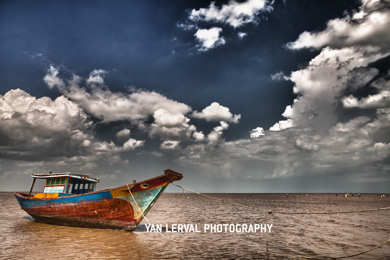 Boat on a beach in Can Gio at low tide. Hdr., Vietnam