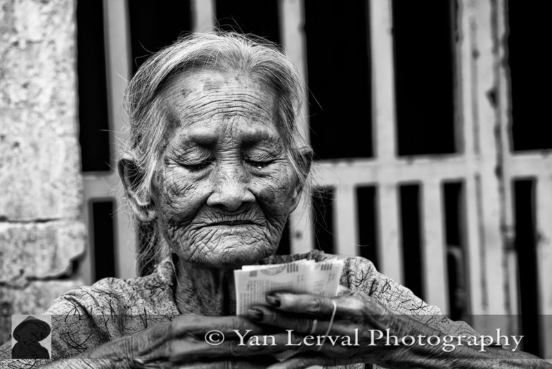 Old woman selling lottery tickets in Go Dau, Tay Ninh Province
